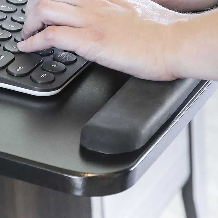 A hand typing on keyboard that is using Seville 360 one of the most popular keyboard tray for standing desk