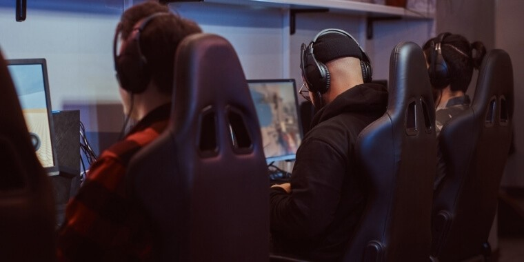 Esports gamers playing a computer game because they are most vulnerable for having a carpal tunnel from gaming