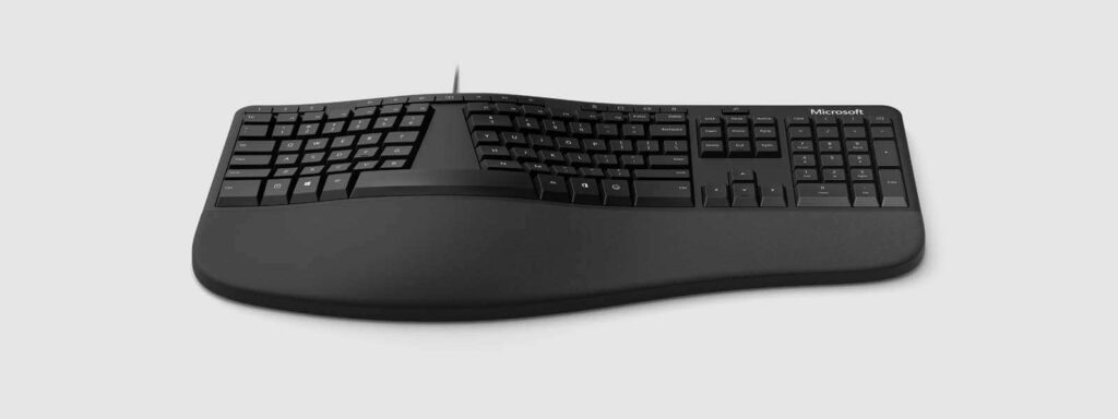 Microsoft LXM 00001 split keyboard design that has improved cushioned palm rest and shortcut keys to better prevent carpal tunnel symptoms.
