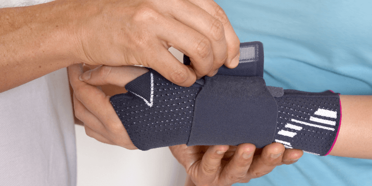 Doctor showing how to use wrist splint
